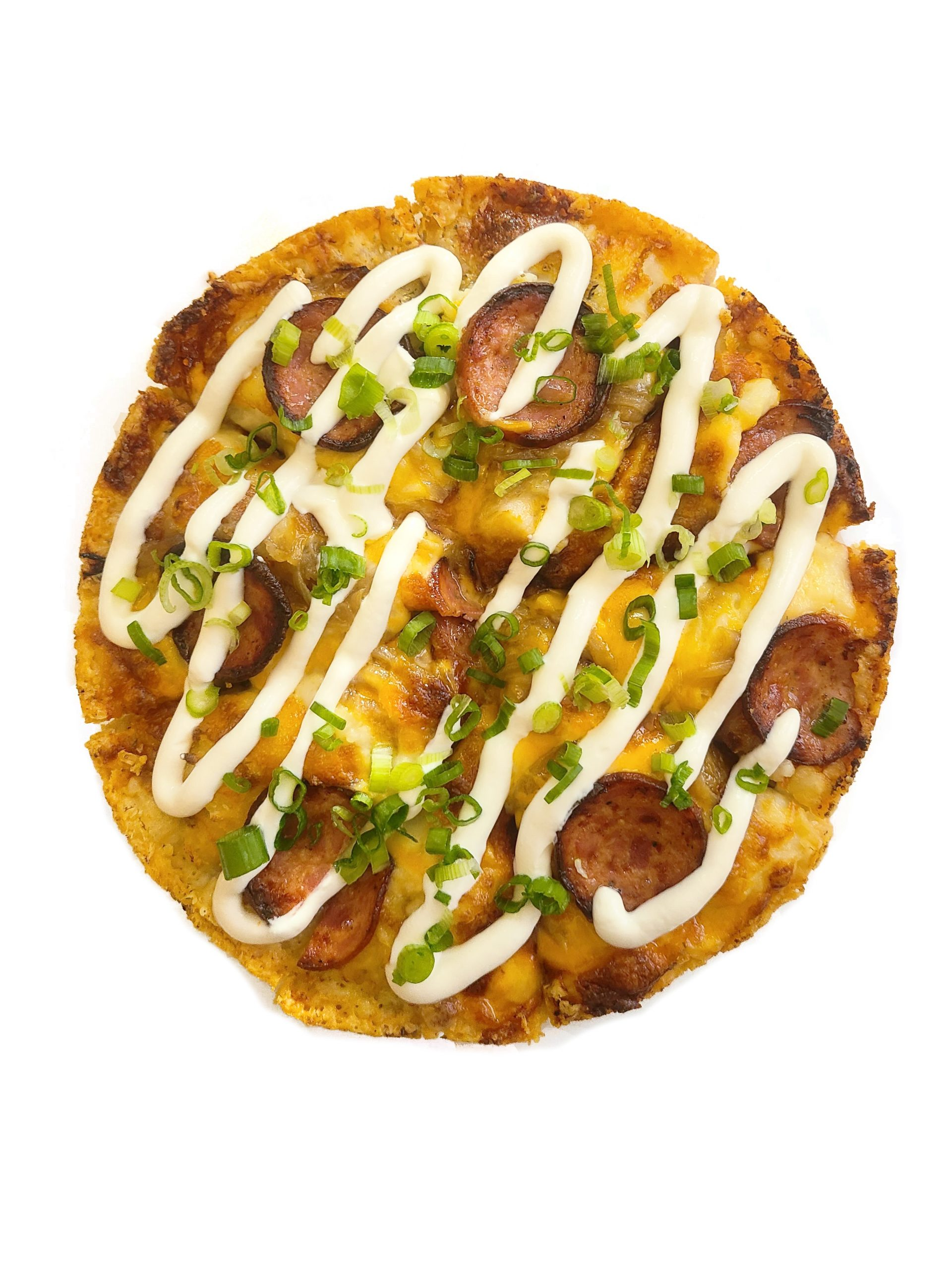 overhead image of pierogi pizza with drizzled sour cream